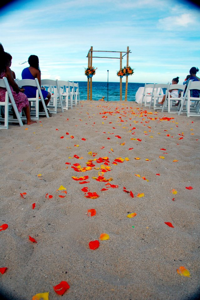 Beach Wedding Altar with Teal and Tangerine Petals